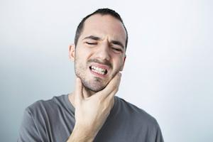 man with jaw pain - emergency dentist Toowoomba