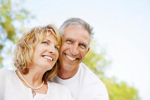 old couple smiling with healthy teeth